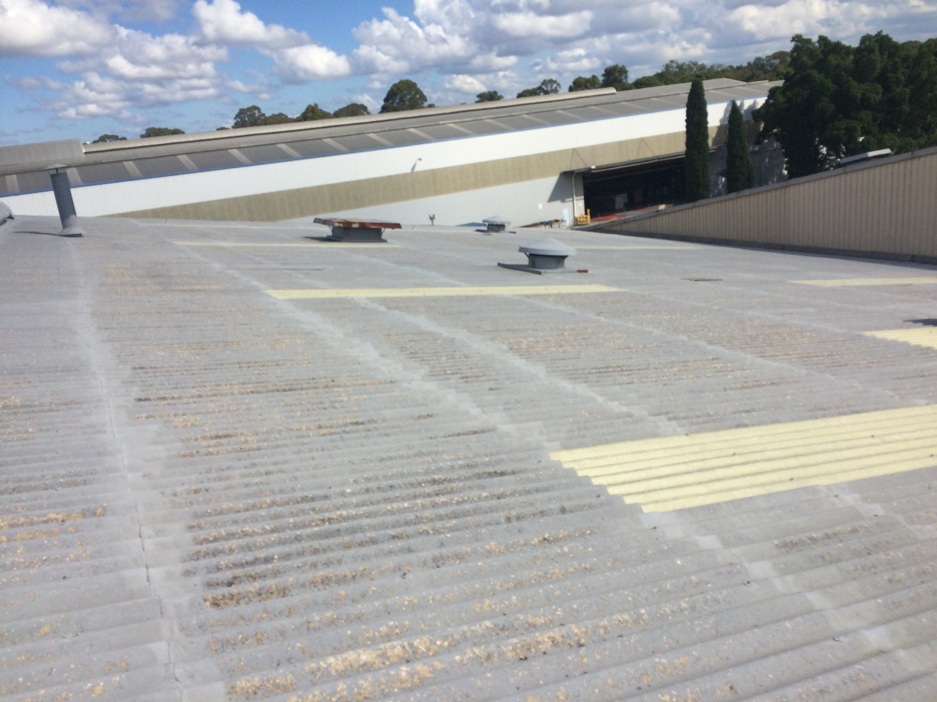 ASBESTOS ROOF SOLUTIONS COMPLETE 16,500M2 RE-COAT OF A HAIL DAMAGED ASBESTOS ROOF IN SYDNEY